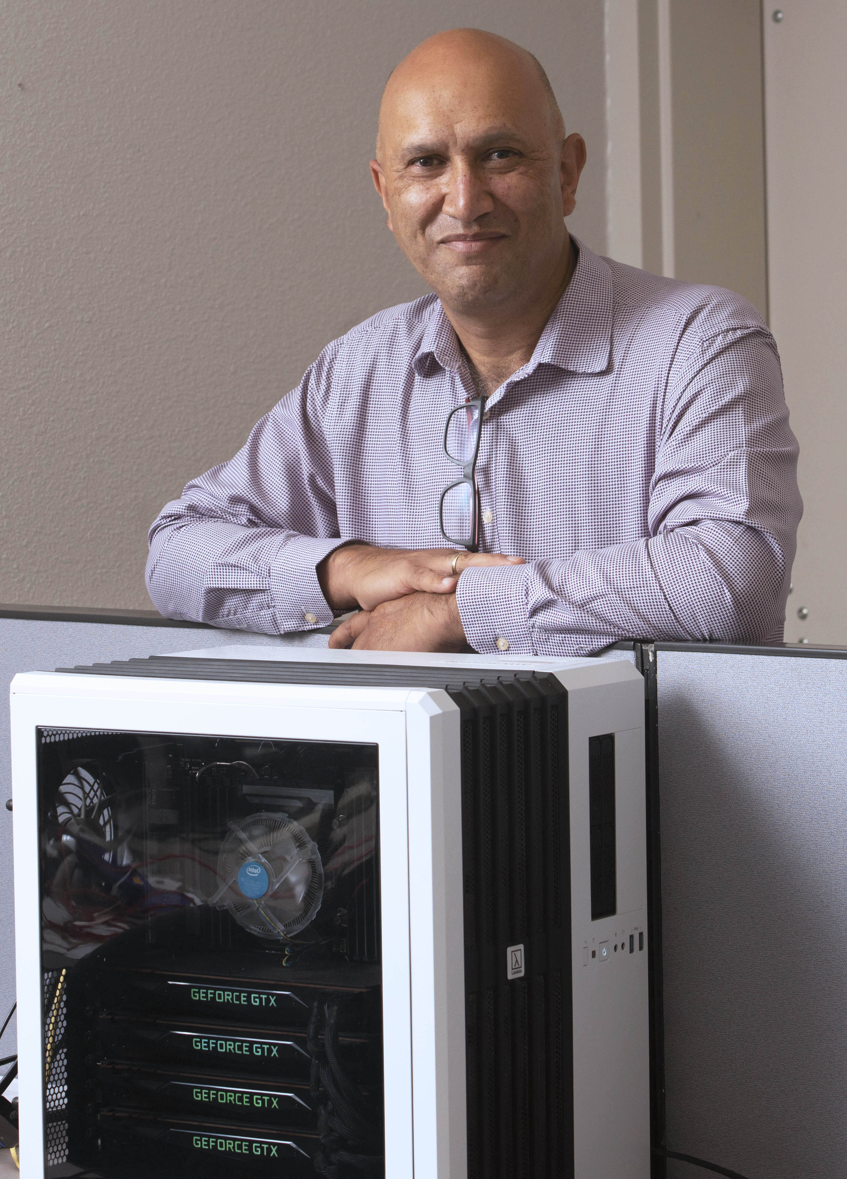 Ian Davidson poses with a computer
