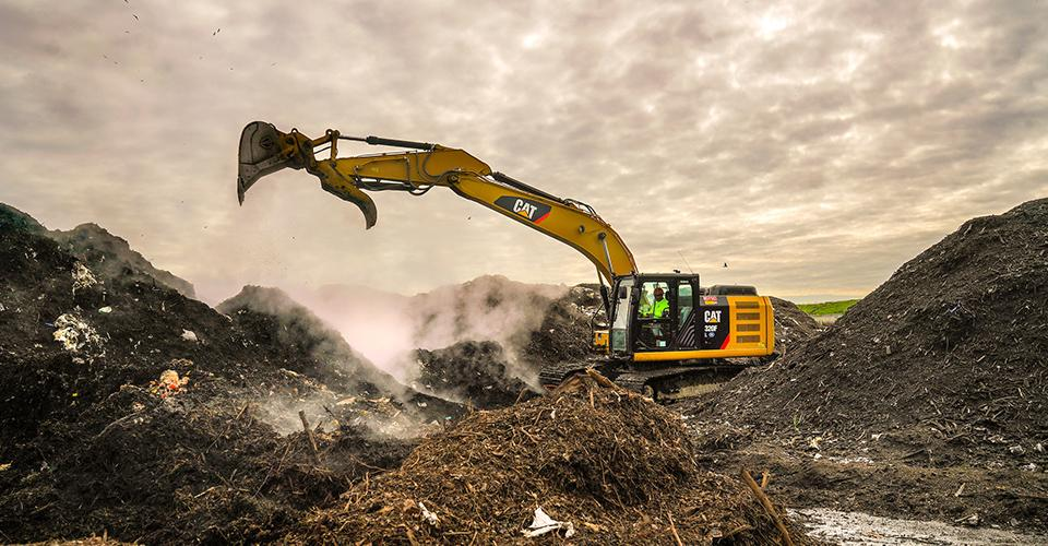 excavator moving compost