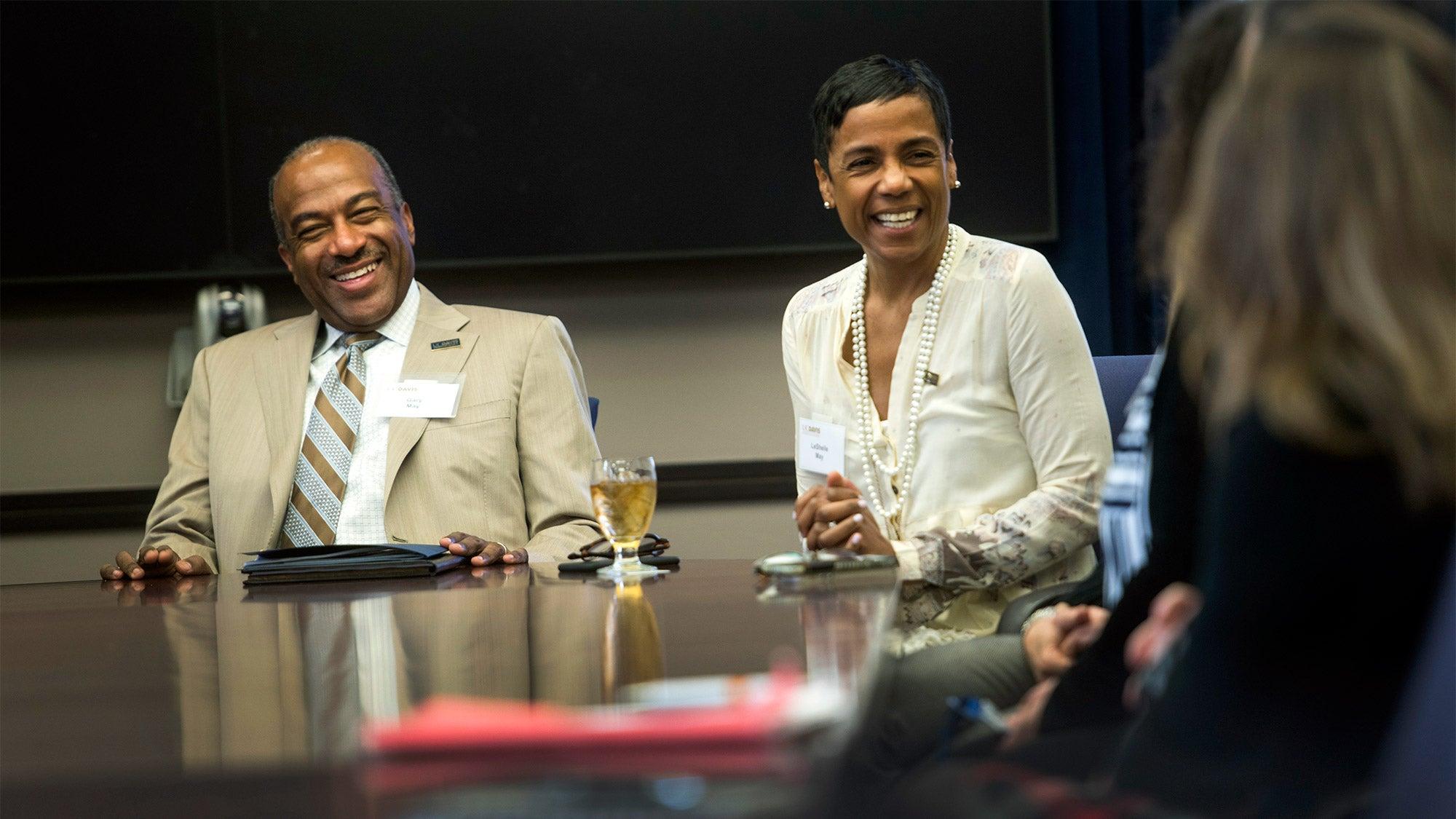 Gary S. May and LeShelle May at a meeting table.