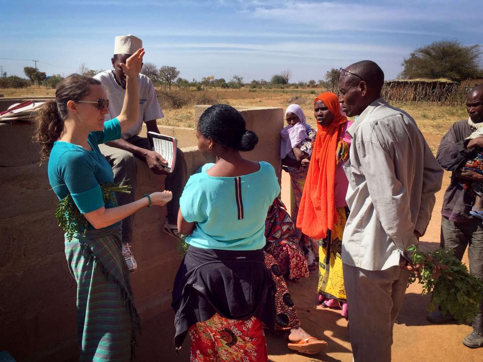 Carrie Waterman talks with Tanzanian community members