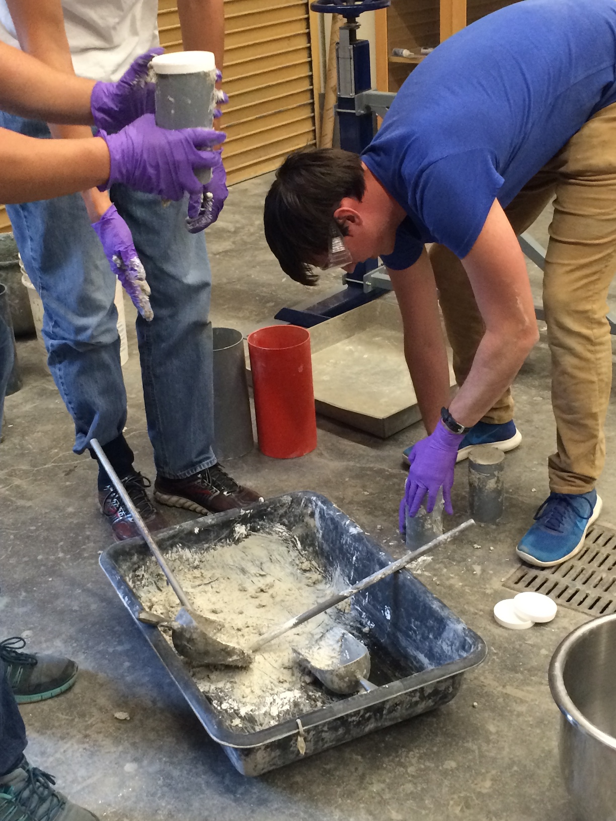 students batch concrete as part of class