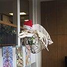 A whale skeleton wearing a Santa hat.