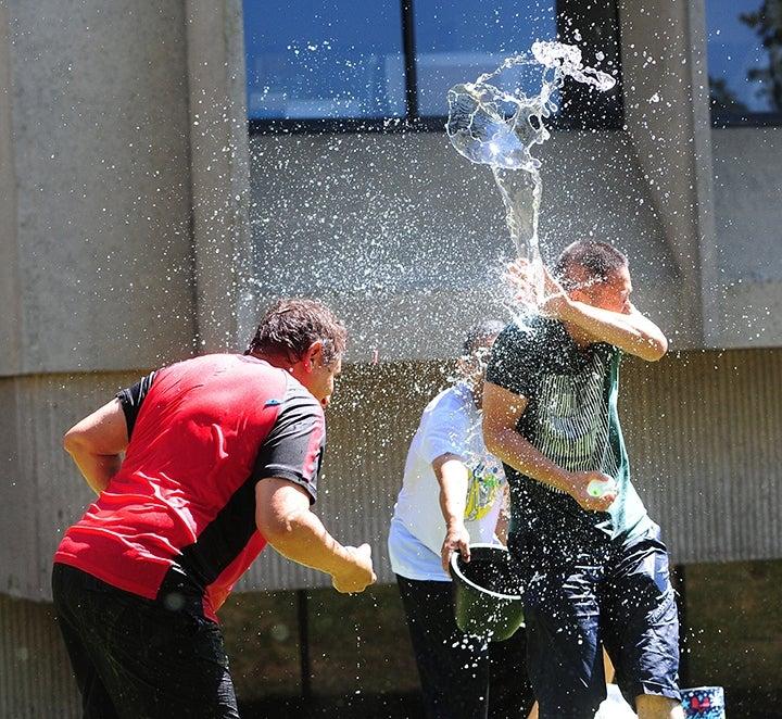 Professors throw water balloons.