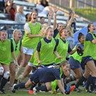 The UC Davis Women's Soccer team celebrates.