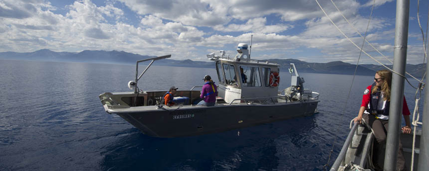 Two research boats manned by science students float on Lake Tahoe