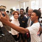 A student takes a selfie with Chancellor Gary S. May.