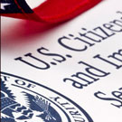 U.S. flag with U.S. Citizenship and Immigration Services letterhead with seal