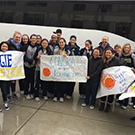 Fans welcome the women's basketball team back to campus.