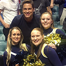Rob Lowe poses for photo with UC Davis cheerleaders.