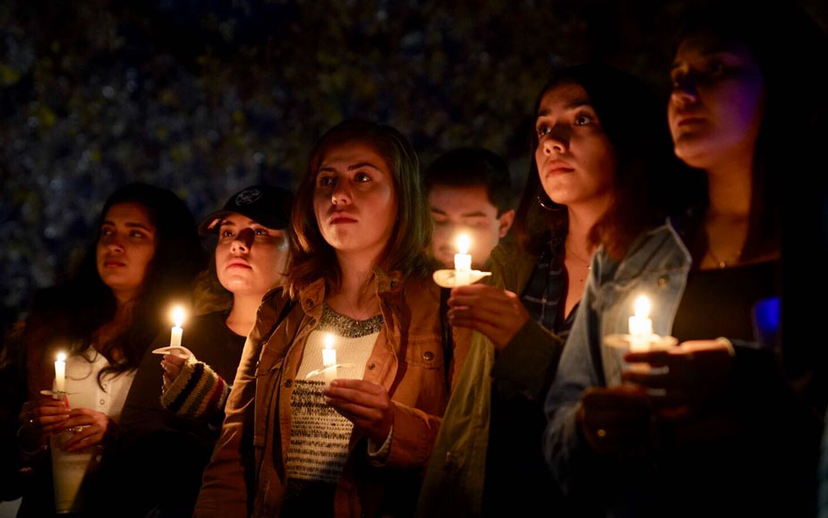 Five women hold candles.