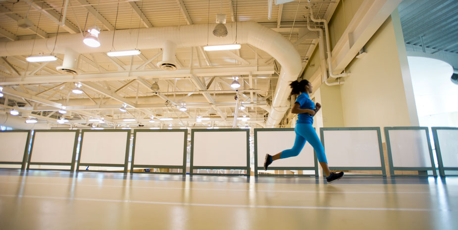 Woman on indoor track at the ARC