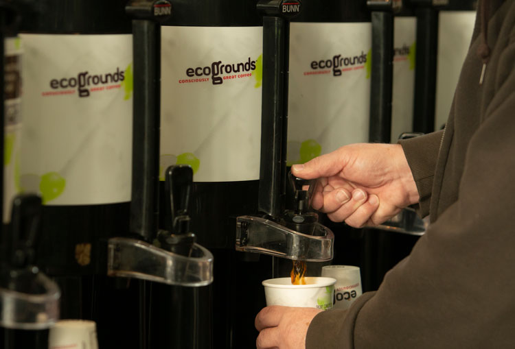 Pouring a cup from ecoGrounds shuttle.