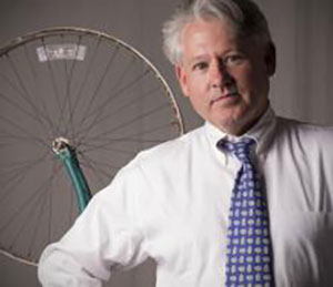 James Housefield against backdrop of bicycle wheel