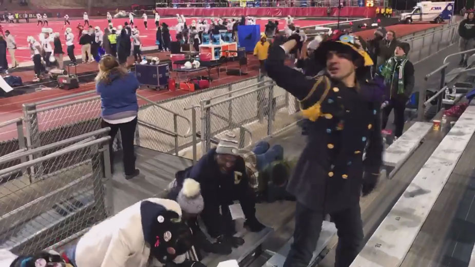 Chancellor May and LeShelle May and others, doing push-ups in the stands.