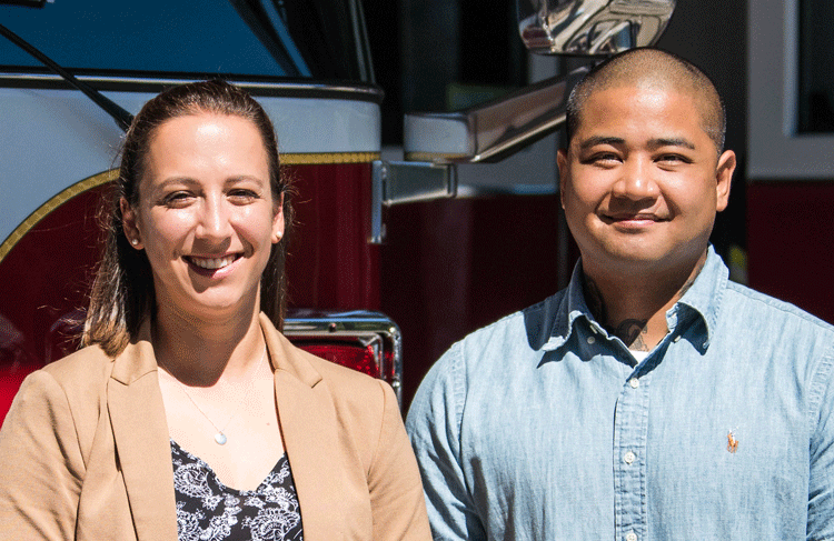 New firefighters Johnita Lanni-Cradit and Chris Lujan in front of firetruck