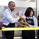 Gary S. May and Annie Adachi cut the ribbon on the Pantry's new location.