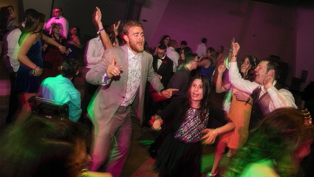 Student Brock Johnson dancing at Shining Stars prom