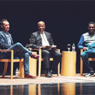 Ben Holton, Gary S. May and GZA on stage.