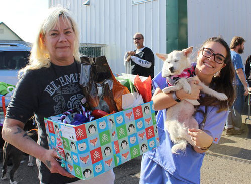 Woman and dog receive Holiday Pet Basket