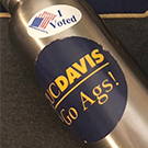 "A water bottle with UC Davis and ""I voted"" stickers."