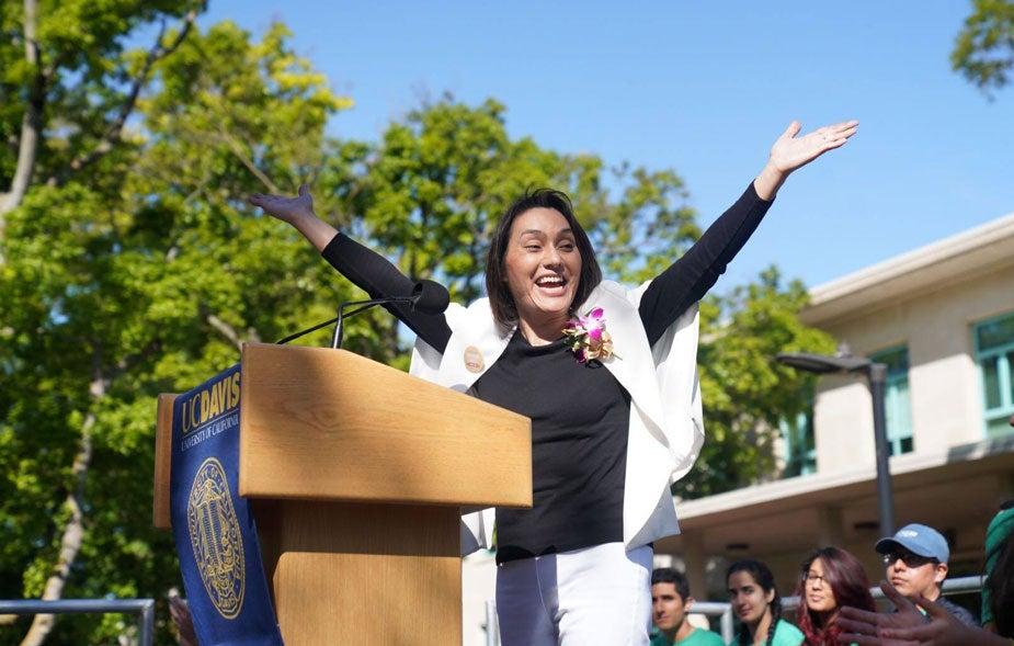 "Picnic Day"" Parade Marshal Sarah Stewart raises arms in celebration."