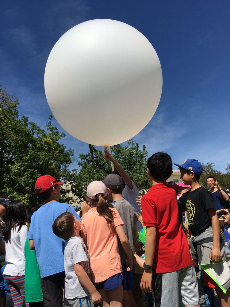 Children launch weather balloon.