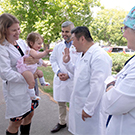 Doctors wave at baby