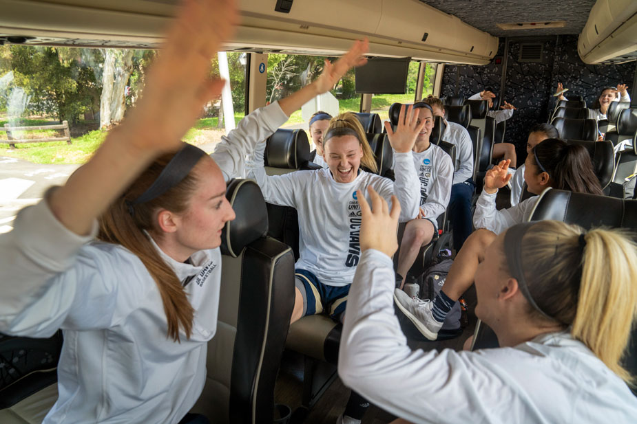 Players move to the music, on bus.