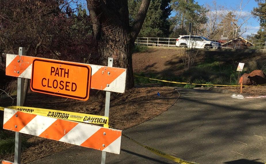 """Sign says """"Path Closed"""" on arboretum patrh, near La Rue Road bridge in background."""