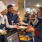 LeShelle May and Chancellor Gary S. May serve food to students.