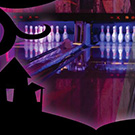 Bowling lanes with purple lighting.