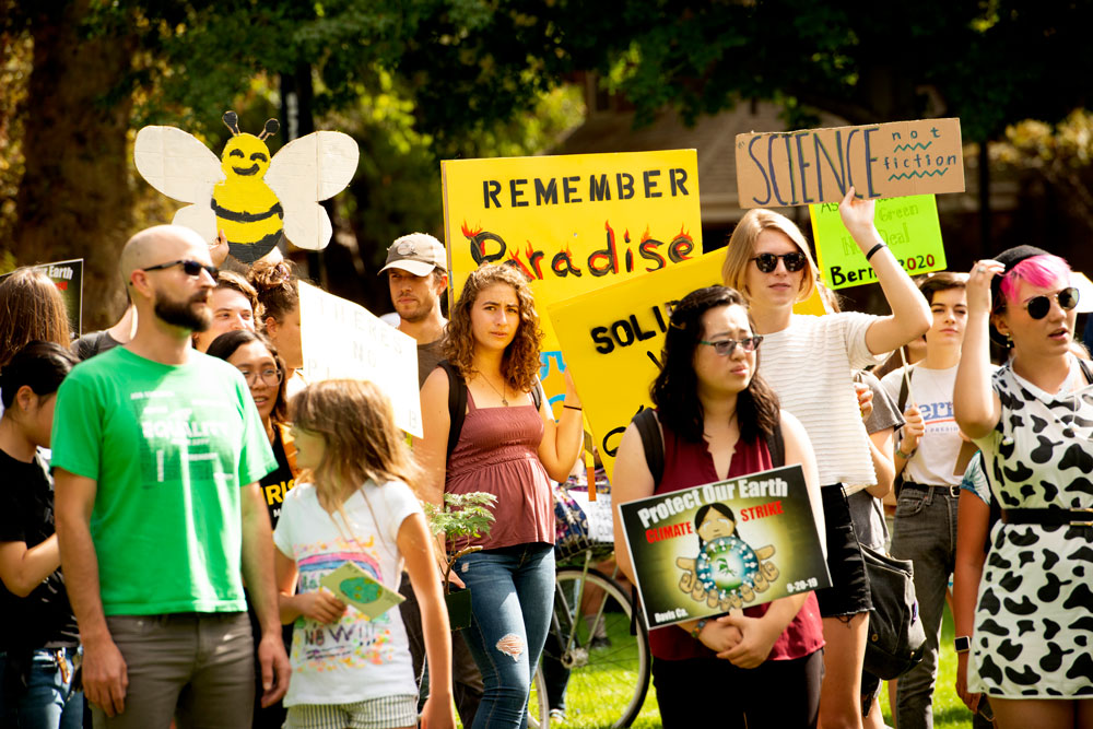 Climate strikers include one with a bee headdress.