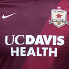 UC davis Health soccer jersey, cropped