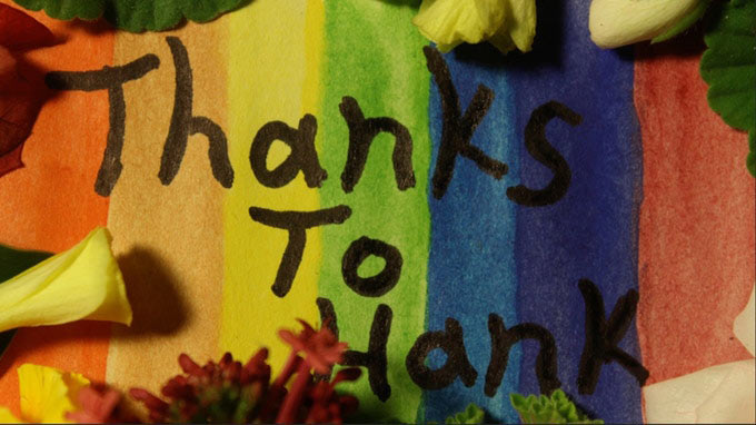 """Thanks to Hank"" written over rainbow-colored background."
