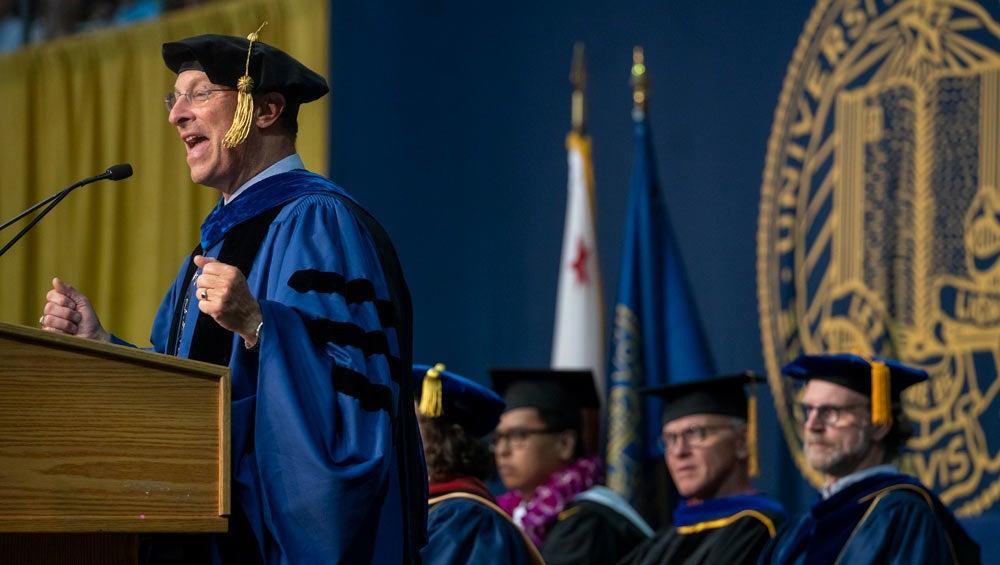 Ralph J. Hexter, in commencement regalia, addresses graduates.