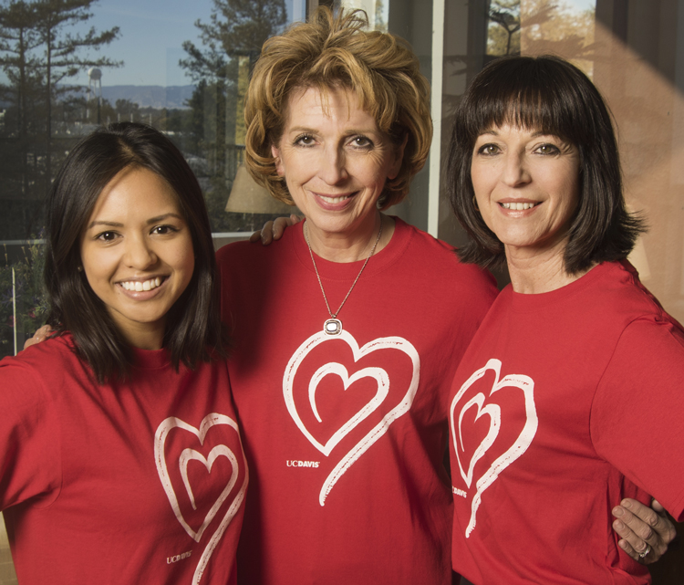 Three women in red heart T-shirts