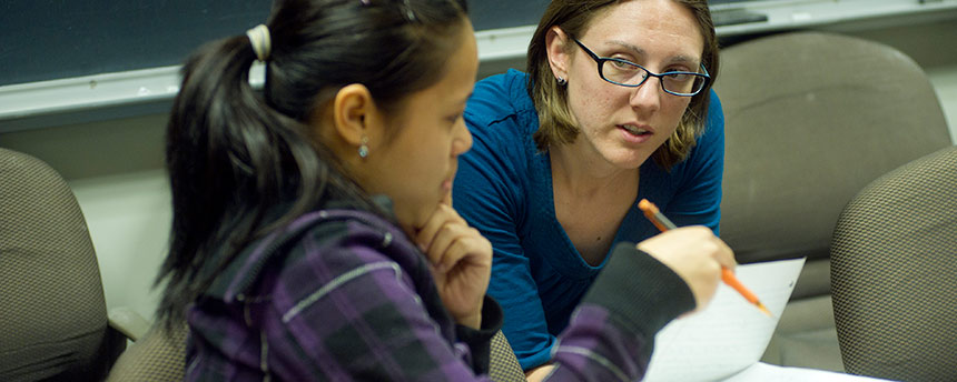 Female student getting tutoring from a woman in a classroom