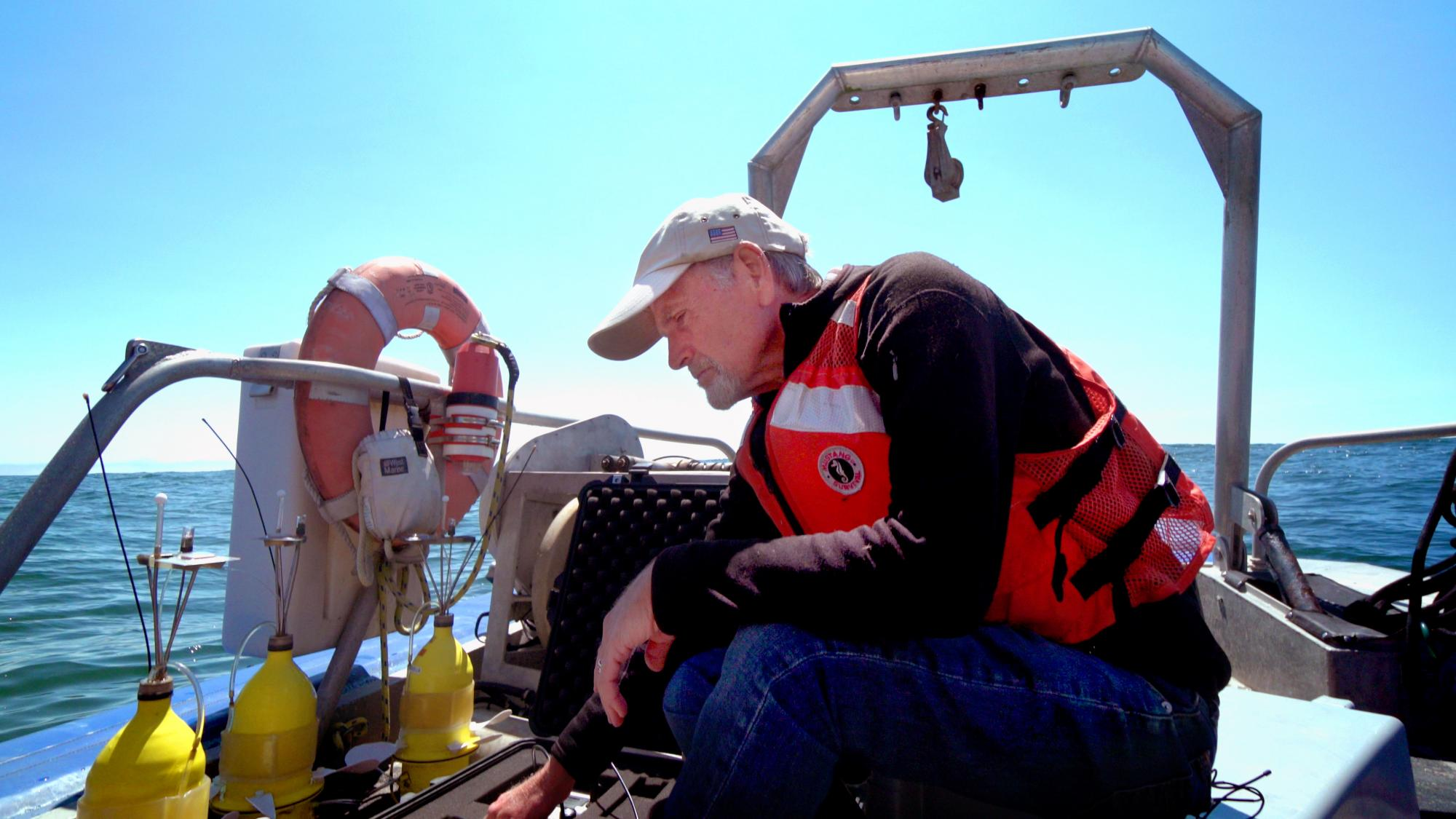 Male scientist on boat