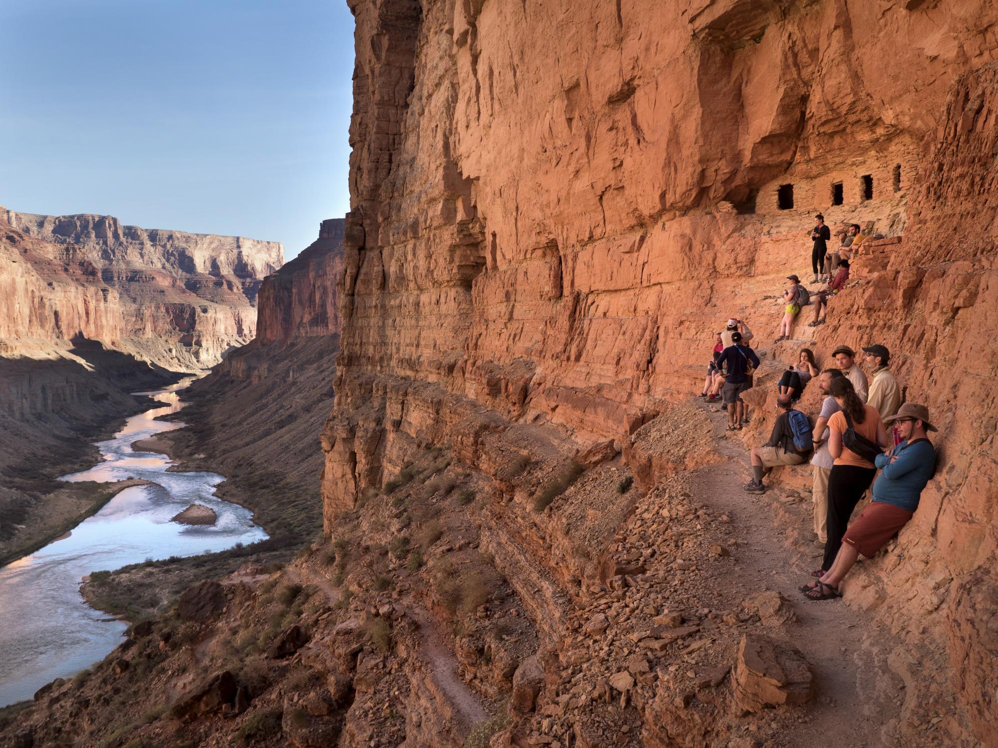 University students at Nankoweap granary ruins, overlooking Colorado River in Grand Canyon