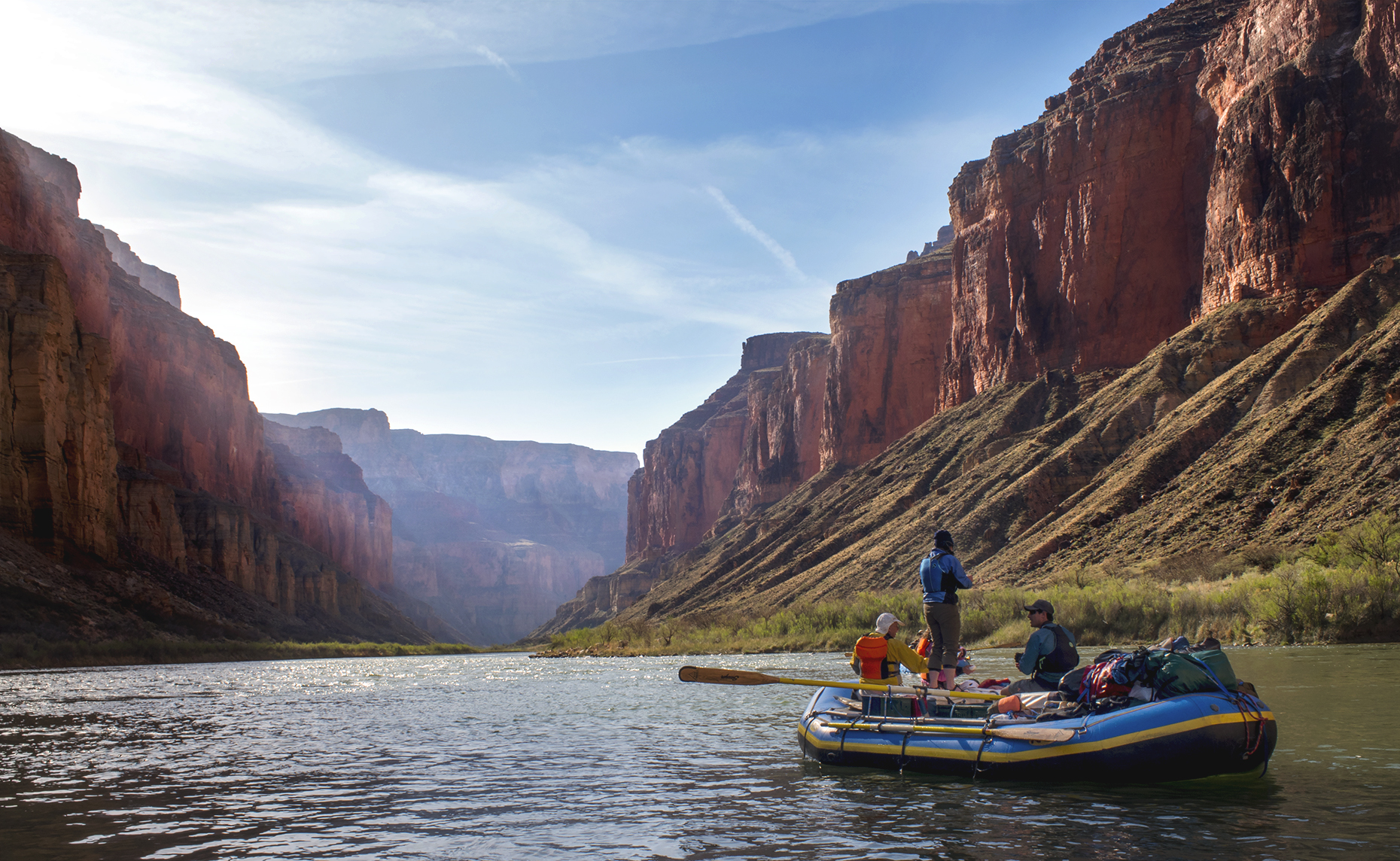 Two men and woman in raft in Grand Canyon