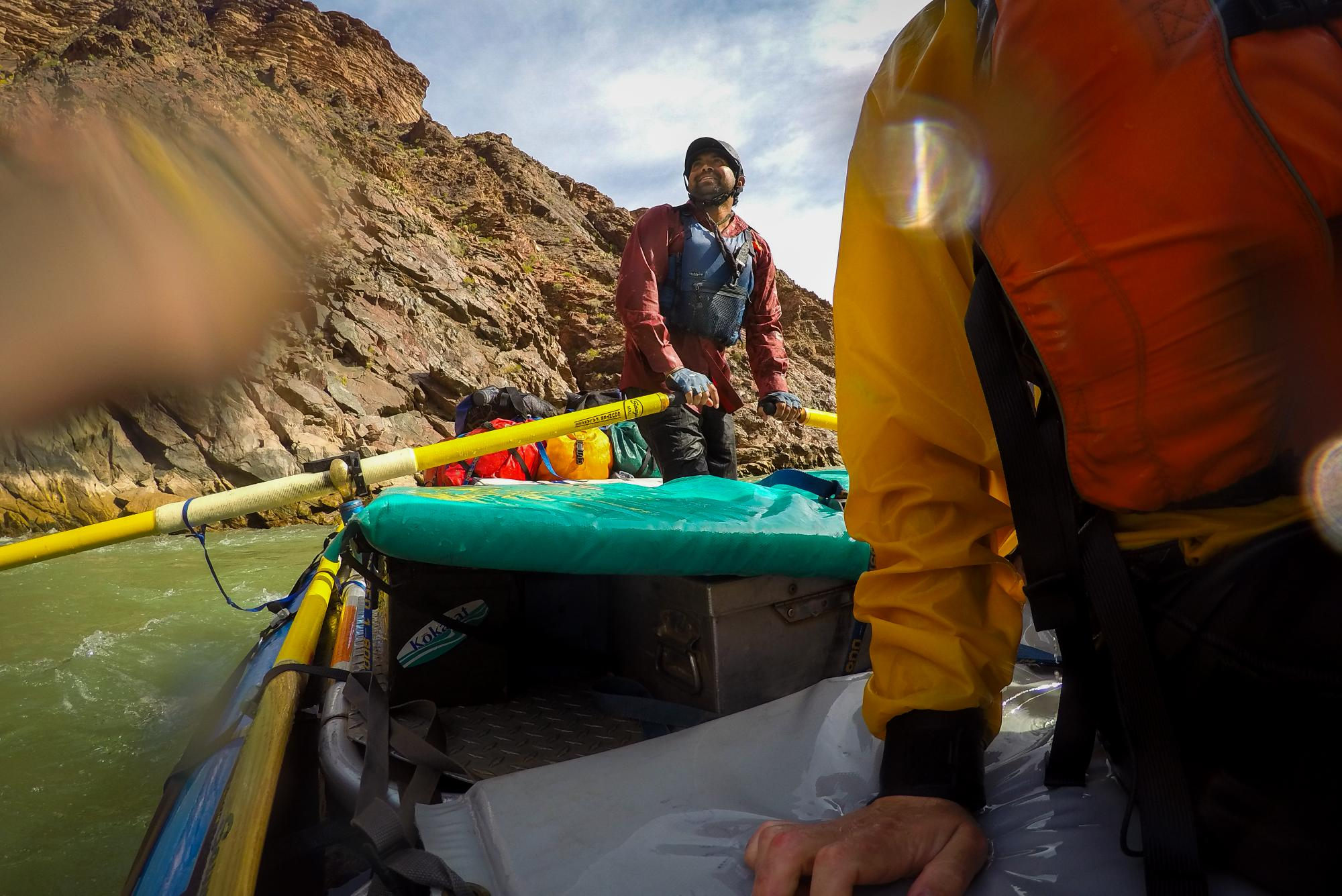 River guide rows raft on Colorado River in Grand Canyon