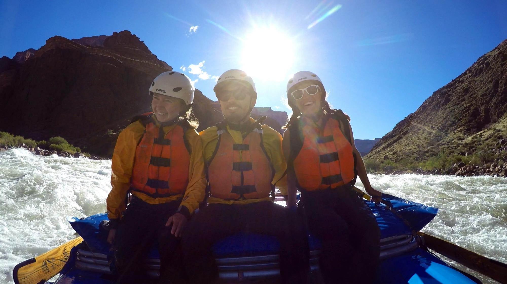 Two women and a man whitewater raft