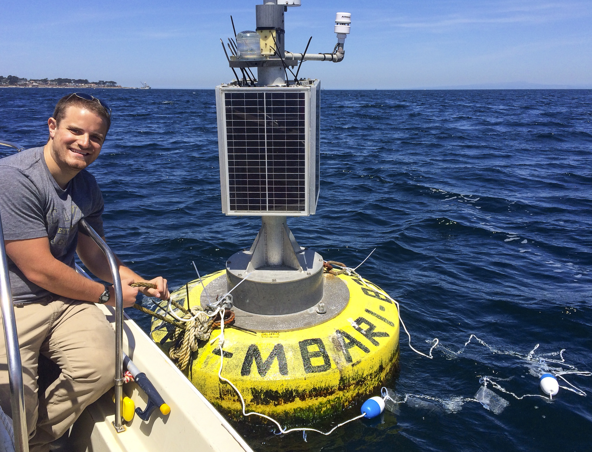 Scientist at research buoy