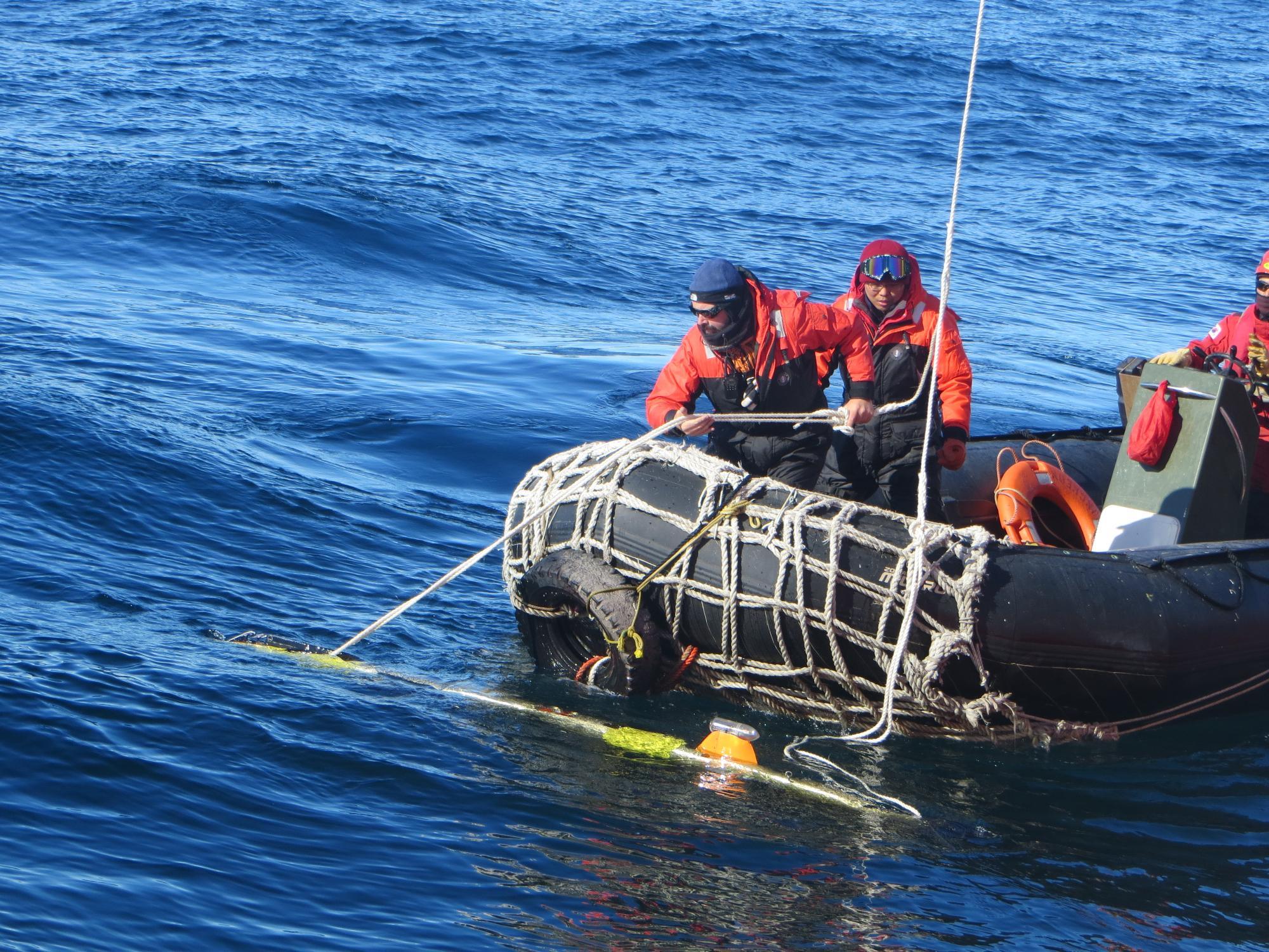 scientists on boat, Antarctica