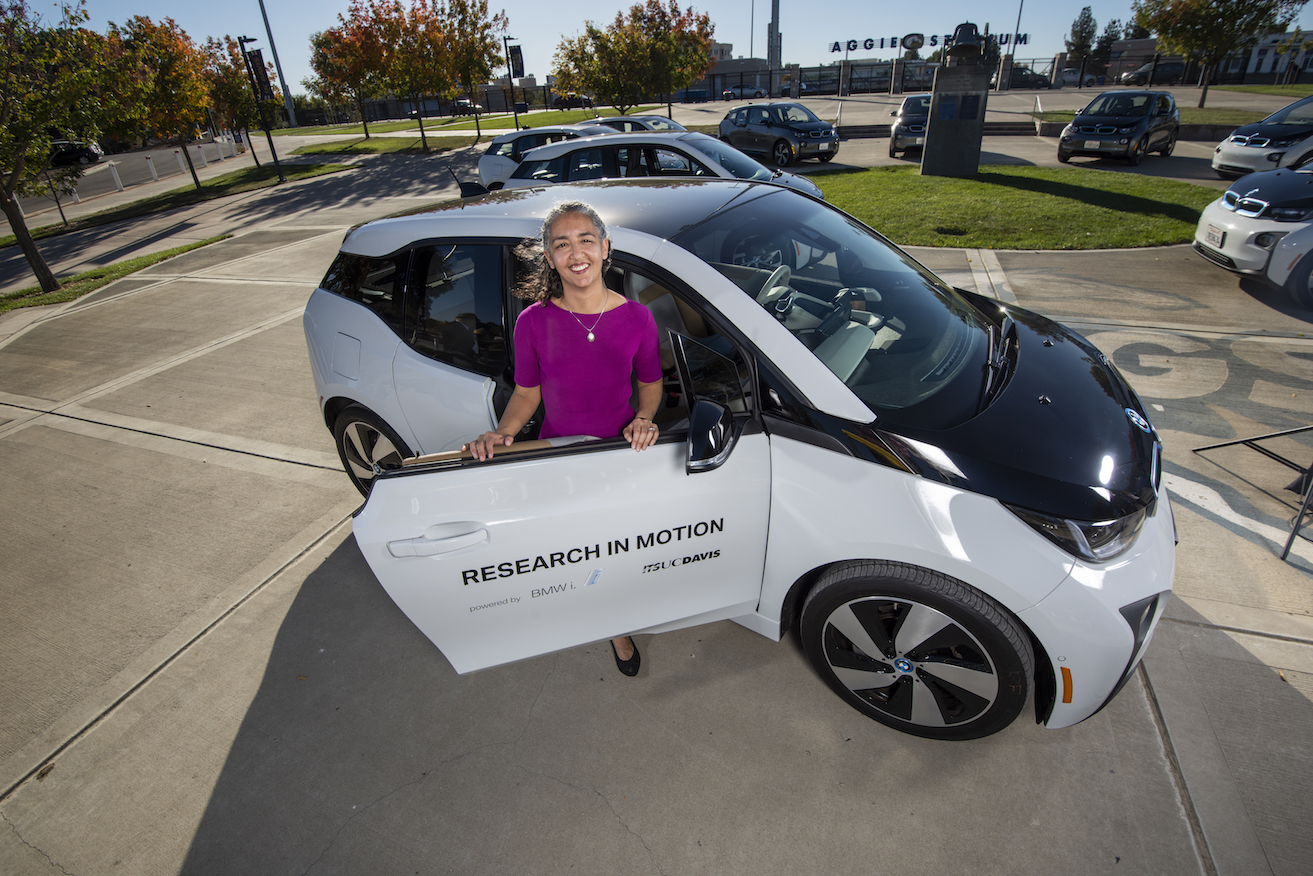 Woman researcher by electric vehicle