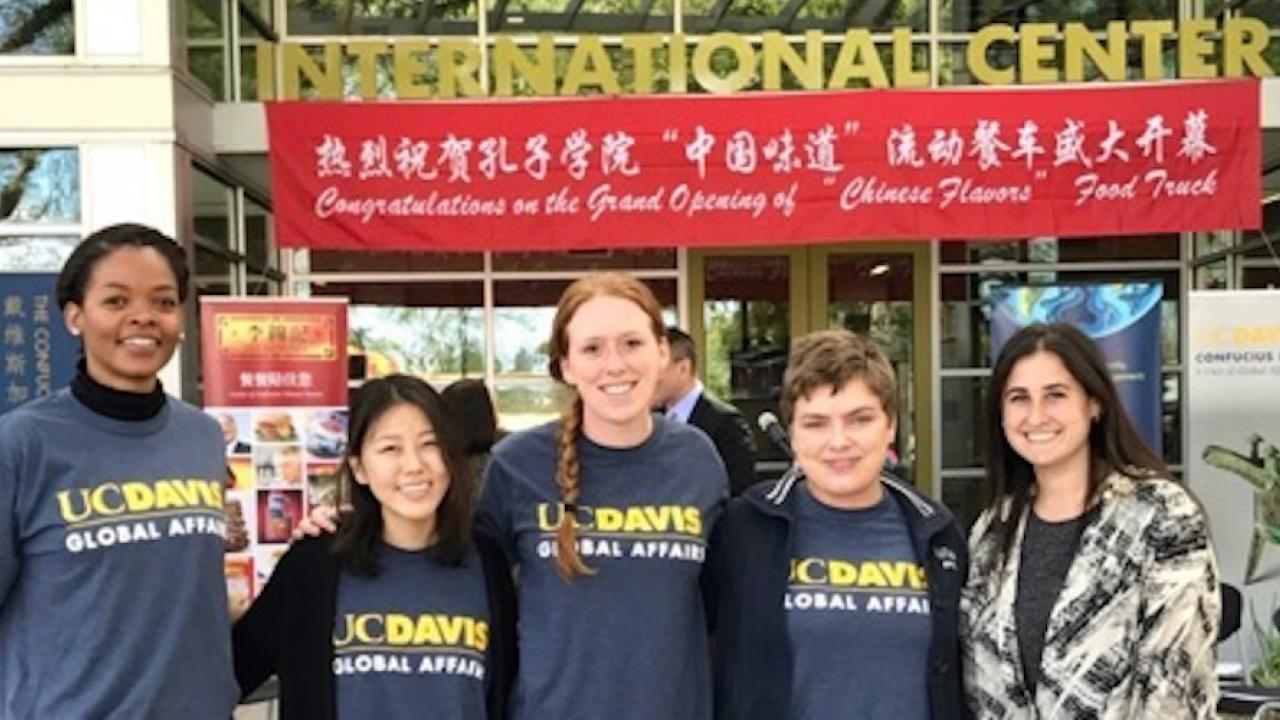 Global Affairs Student Assistants support the opening of the Chinese Flavors Food Truck in front of the International Center