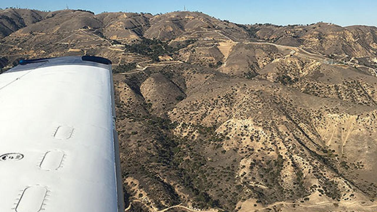 Aerial view of Southern California hills with sky in background