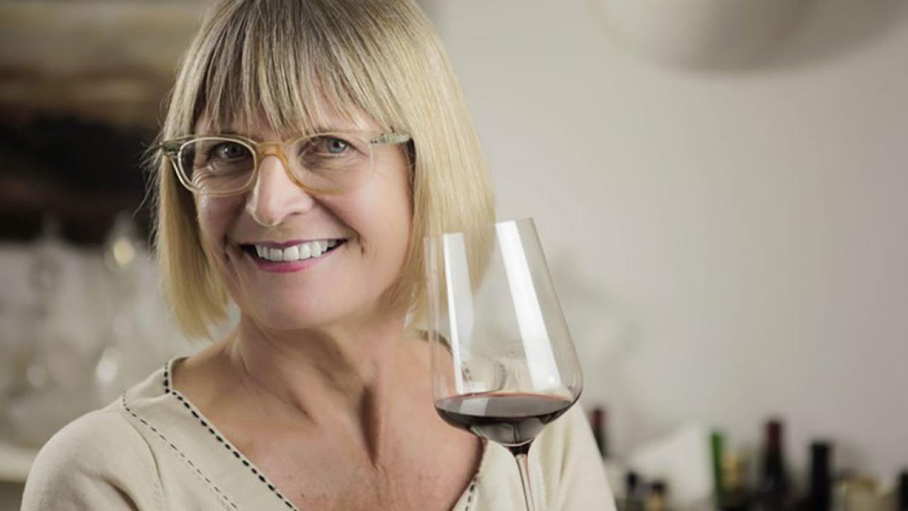 Jancis Robinson holds a glass of wine