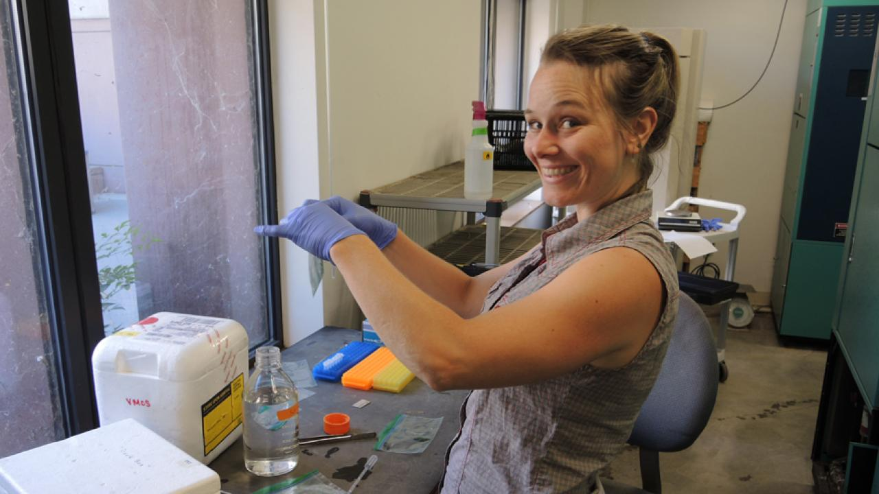Photo: Smiling Sharon Gray in lab.