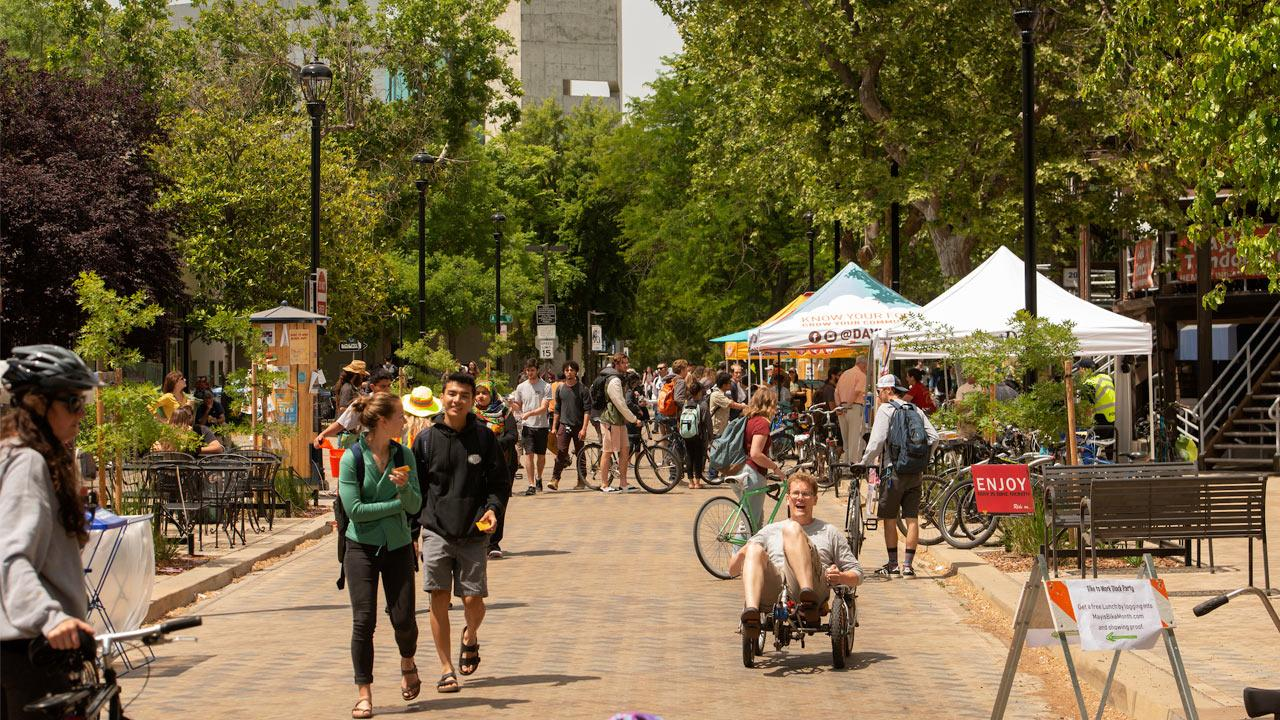 A view of a downtown Davis street full of students